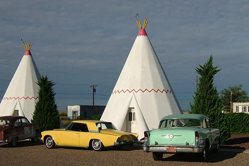 Historic WigWam Motel with vintage cars