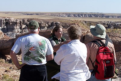 Visitors listen to a ranger on a program