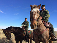 Two park staff members on horseback
