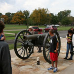 Ranger with students discussing artillery during the Civil War and the Battle of Pea Ridge.