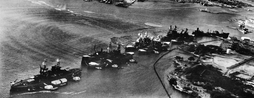 Battleship Row at the start of the Pearl Harbor attack; the mooring quays can be seen near the battleships.