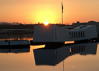 The USS Arizona Memorial and mooring quay at sunset.