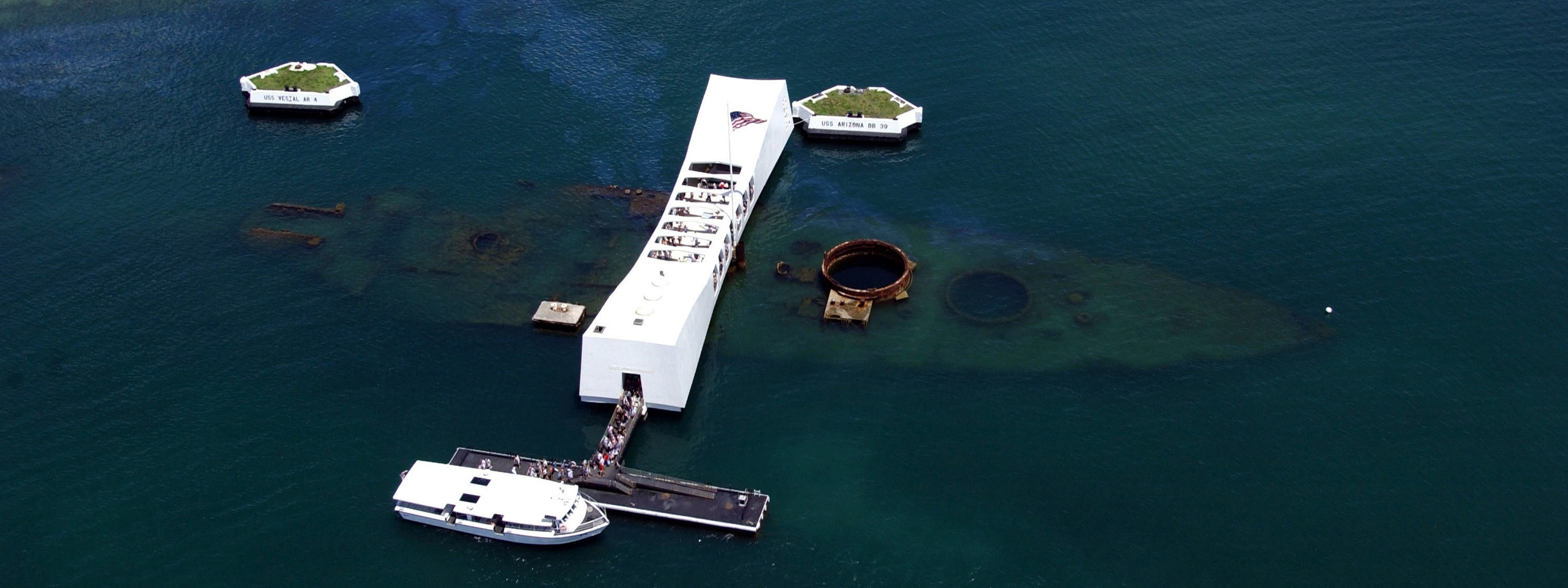 An aerial view of the USS Arizona and the memorial.