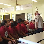 Elementary school kids listen to Pearl Harbor civilian witness Jimmy Lee during a pre-site visit.