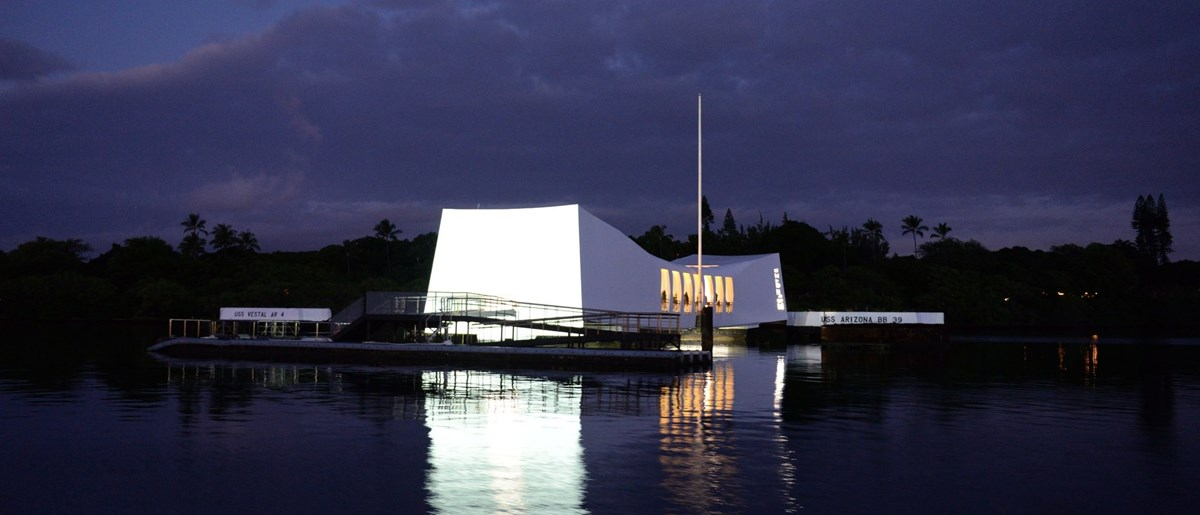 The USS Arizona Memorial at night.