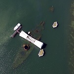 The USS Arizona and memorial, aerial view.