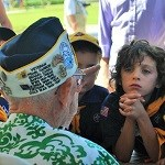Cub Scouts talk to Pearl Harbor Survivor Sterling Cale.