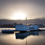 The USS Arizona Memorial at sunset.