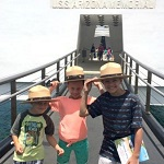 Kids work on their Junior Ranger booklets at the USS Arizona Memorial.