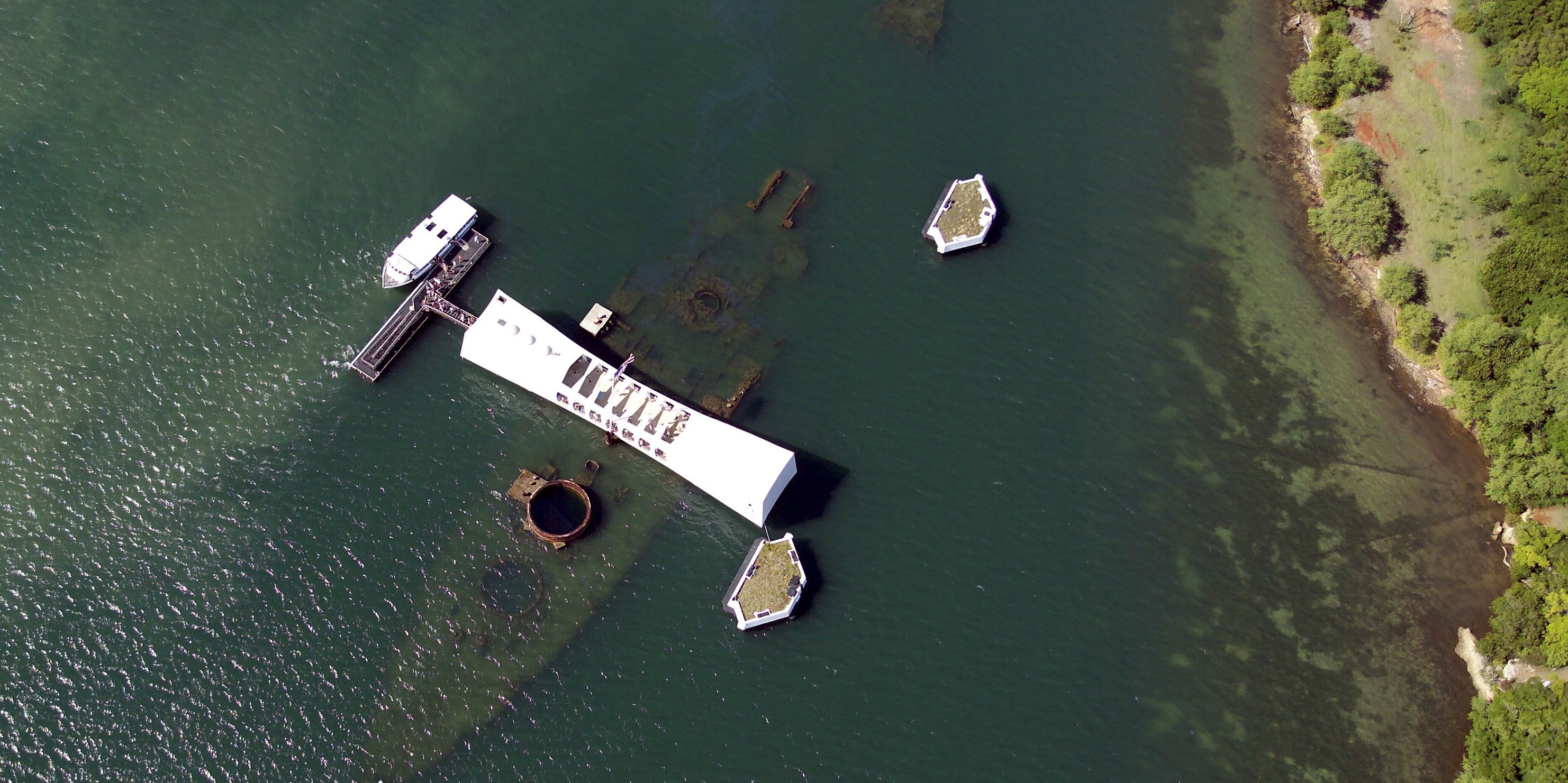 An aerial view of the USS Arizona and memorial.