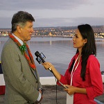 A reporter interviews Professor David Kennedy at the 74th commemoration of the Pearl Harbor attack.