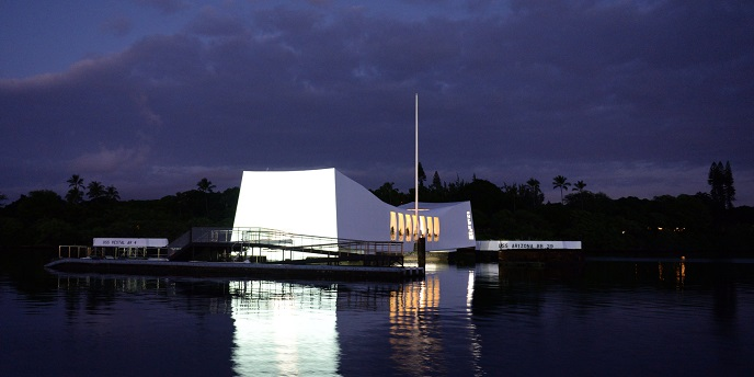 The USS Arizona lit up at night.