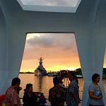 The Battleship Missouri, seen from the USS Arizona Memorial at sunset.