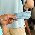 A visitor holding two tickets.