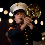 A US Marine plays the trumpet during a concert.