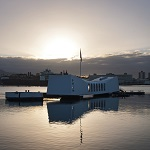 A view of the USS Arizona Memorial at sundown.