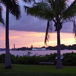 An evening view of the USS Arizona Memorial from the Pearl Harbor Visitor Center.