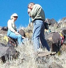 Two Volunteers photographing petroglyphs