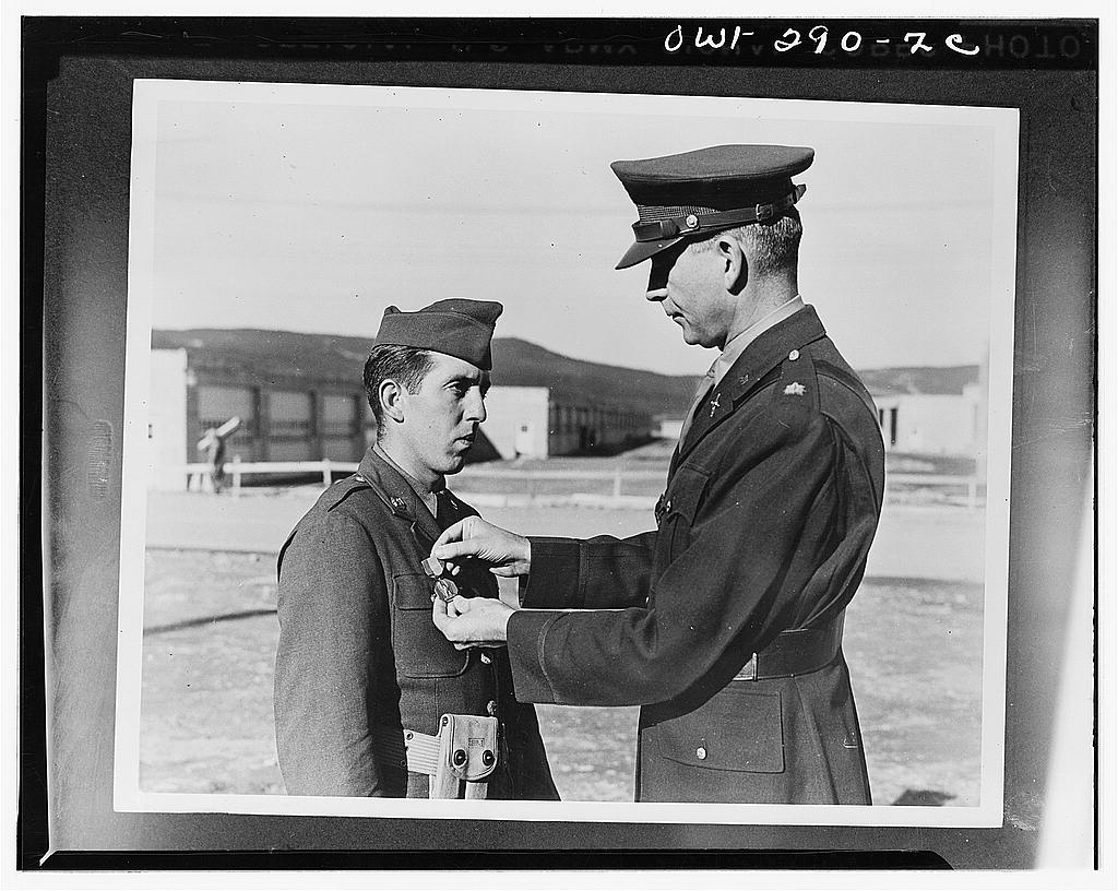 Private Andrew Shestock receiving the Soldiers Medal from Lieutenant Colonel E.E. Reid of the Newfoundland command for saving a Newfoundland citizen from drowning