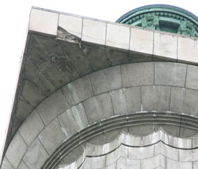 Damaged granite facing below observation deck of Perry's Victory