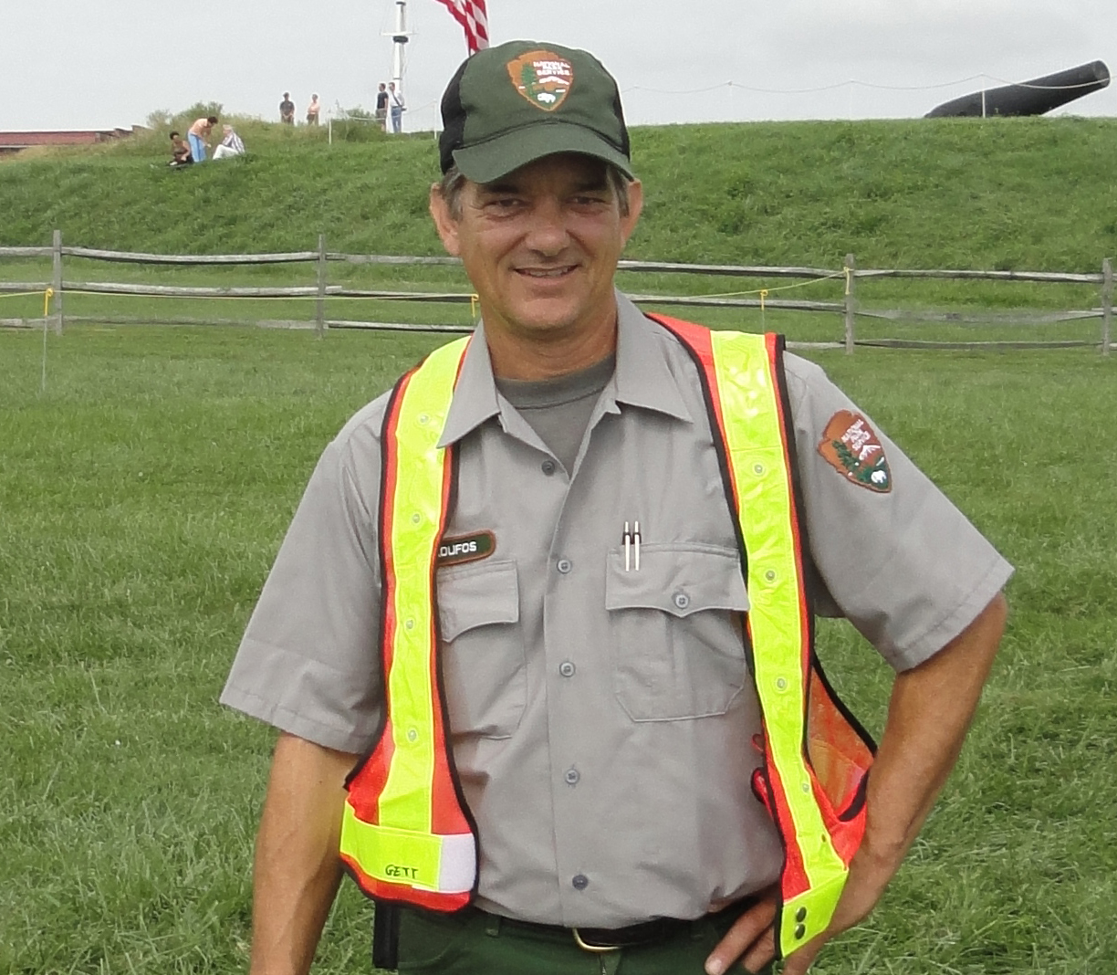 Dan Skoufos wearing the NPS maintenance uniform and orange vest.