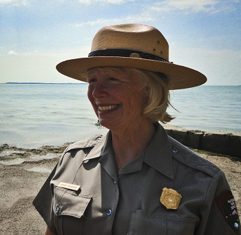Smiling Park Ranger on beach