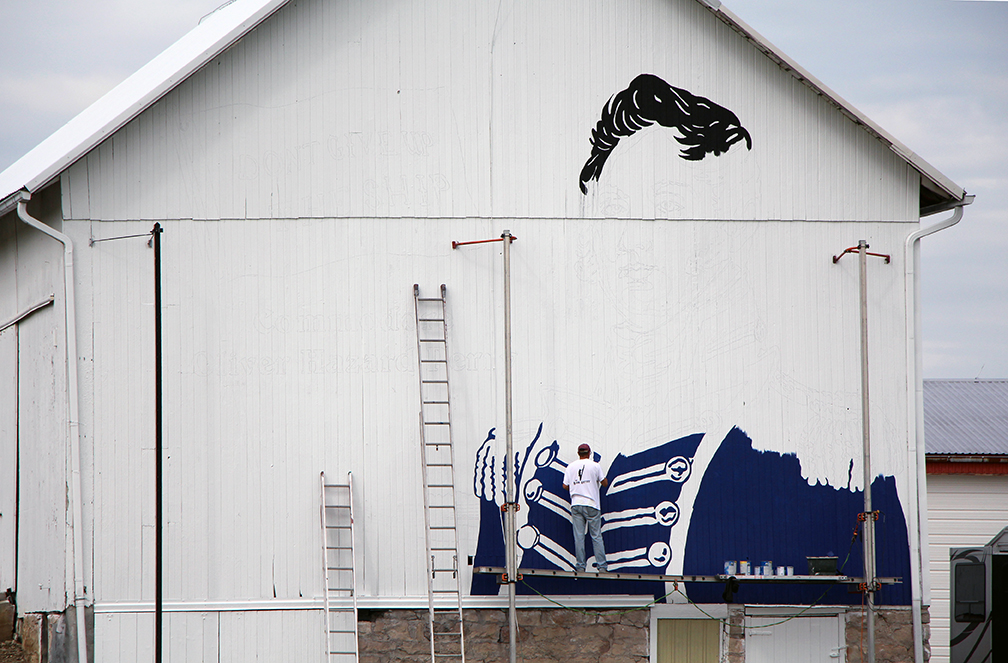 Barn artist Scott Hagan paints an image of Oliver Hazard Perry on the side of the Schimming's barn on SR 105 just west of Oak Harbor as part of the Ohio History Connection Barn project.