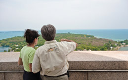 Visitors over looking Lake Erie from atop Perry's Victory and International Peace Memorial