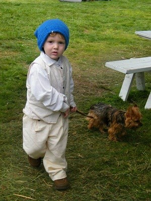 Volunteer in historic clothes & dog