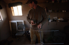 A biologist readies his tracking equipment in the observation blind on the morning of the release event.