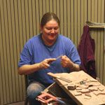 Cultural demonstrator shaping pipestone item