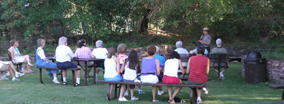 An evening interpretive program is given by a Park Ranger.
