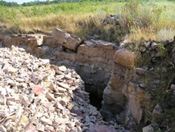 Quarry site showing the quartzite wall and quartzite rubble pile.