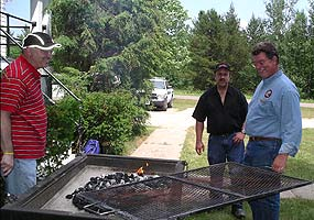 John, Don and Gregg around the barbeque at the employee reunion.