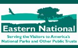 The green and white logo for Eastern National feature a landscape with tree and bird.