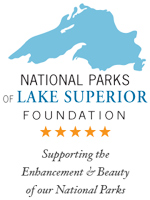 The blue on white logo of the National Parks of Lake Superior Foundation features on outline of this Greatest Lake.