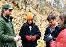 Park Ranger and middle school students on a autumn field trip to Munising Falls.