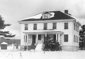 This black and white photo depicts the Munising Coast Guard station in 1968.