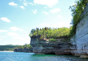 Blue sky, sunshine, Lake Superior, and the Pictured Rocks cliffs.