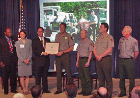 Pictured Rocks National Lakeshore employees receive the 2002 White House Closing the Circle Award.