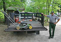 Maintenance Worker prepares to mow at Little Beaver Lake Campground.