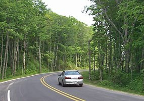 Visitor drives on a recently paved portion of Alger County Road H-58.