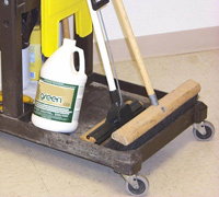 This custodian's cleaning cart contains non-toxic products, and of course a broom.
