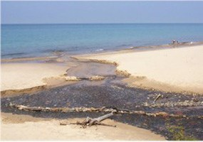 Sullivans Creek flows into Lake Superior at a beautiful white sand beach.