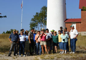 The 2006 participants of the Experience Your Lakeshore program pause for a photo in front of the Au Sable light tower.