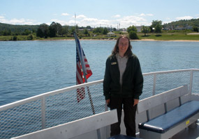 National Park Foundation Interpreter Catherine Kimar aboard the Pictured Rocks Cruises ship Grand Island as the ship readies for Lake Superior.