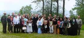 Newly naturalized citizens pose with Judge Greeley and Superintendent Northup near Miners Castle.