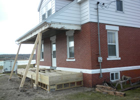 Construction of a new porch on the Grand Marais Harbor of Refuge historic Coast Guard building.
