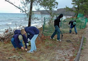 Students from Munising High School volunteer to maintain the trail along Miners Beach.