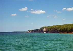 Lake Superior's clear waters appear emerald green on this sunny summer day along the Pictured Rocks.